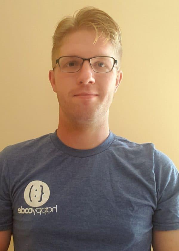 Instructor Photo with Happy Code Logo Tshirt